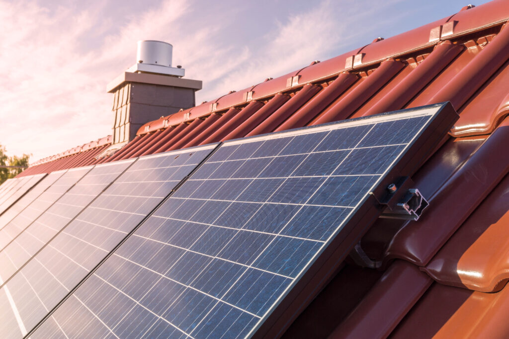 solar panesl or photovoltaic plant on the roof of a house